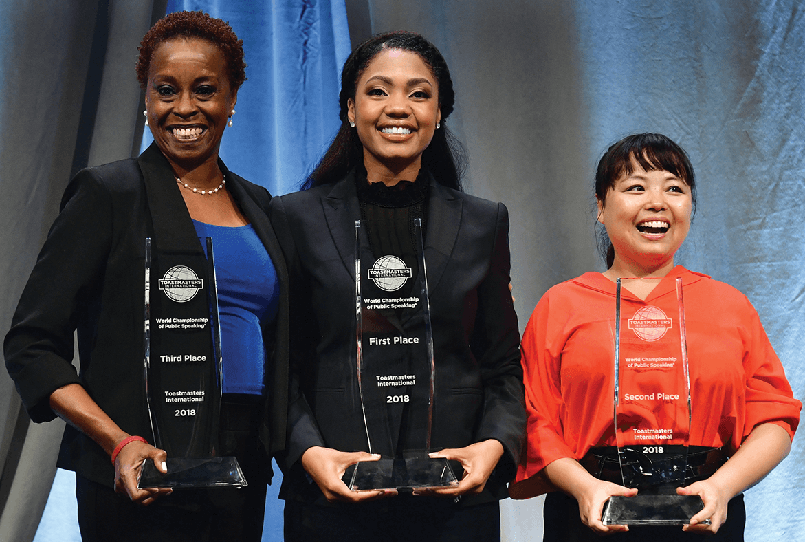 "Ramona J. Smith (center), World Champion of Public Speaking, stands with Zifang ""Sherrie"" Su, second-place winner (right) and Anita Fain Taylor, third-place winner."